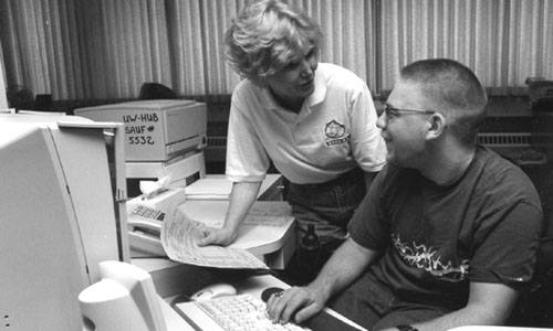 Picture of Director Sheryl  Burgstahler and Ambassador Ryan working on a computer together.