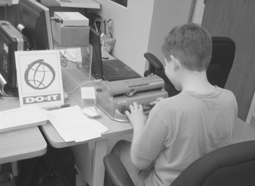 Picture of a student using a braille machine.