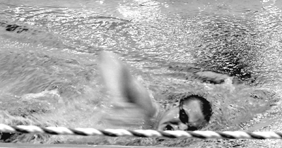 Picture of Justin swimming.
