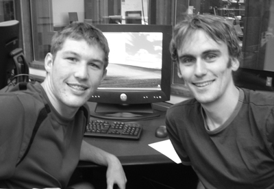 Picture of Zach and and instructor posing at a computer.