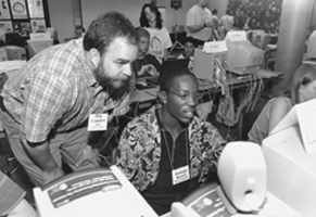 Picture of DO-IT Staff member Dan working with Scholar Raleigh on a computer during Summer Study 2000