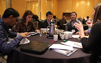 Participants having a discussion around the table.