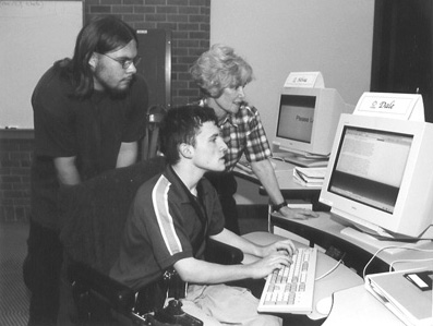 Picture of Caleb, Dale, and Sheryl in computer lab.