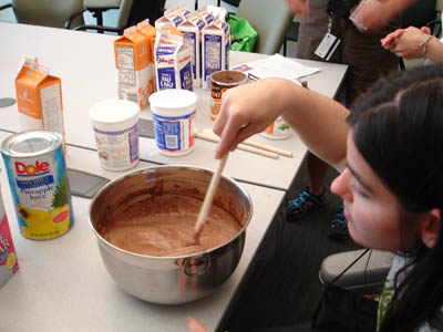 Picture of Jen stirring a bowl of what will become chocolate ice cream.