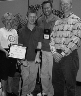 Picture of Sheryl, Michael, Terry, and Daman posing in front of the Trailblazer Award.