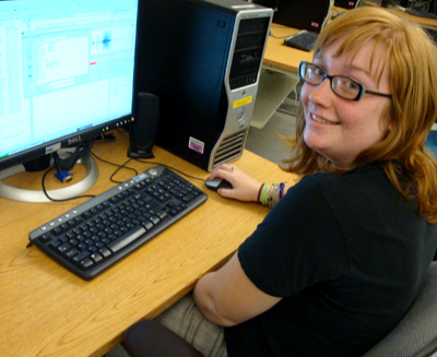 Picture of Kristin at a computer.