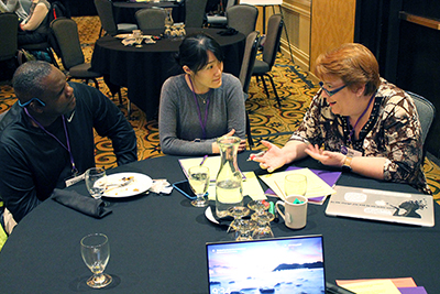 Three participants discuss accessibility issues within computing departments.