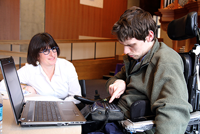 A student uses assistive technology during a mock interview.