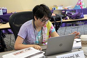 Student works on assignment on her computer