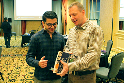 Diversity manager Scott Bellman shows a resource to a participant.