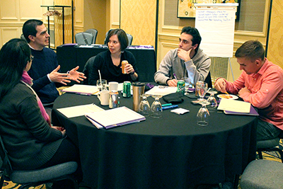 Participants discuss the topic questions.