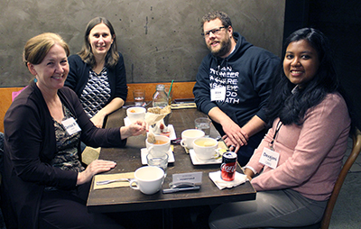 Four participants get to know each other over a meal.