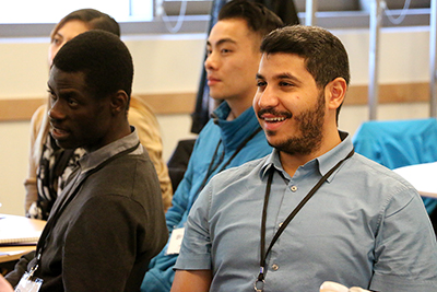 Two participants watch a presentation.