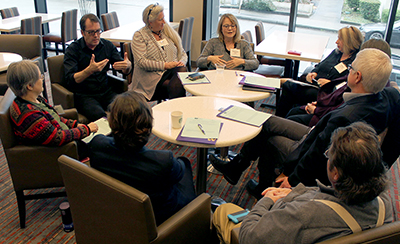 Participants talk about a discussion question in a large group.