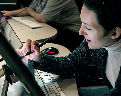 Image of a student using a large desktop tablet