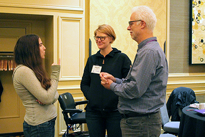 Participants stand and talk with AccessComputing PI Richard Ladner.