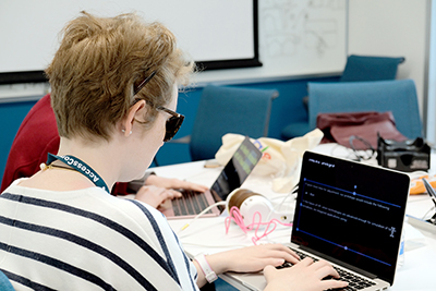 Meredith uses her laptop at the OurCS@UW+AccessComputing conference in April.