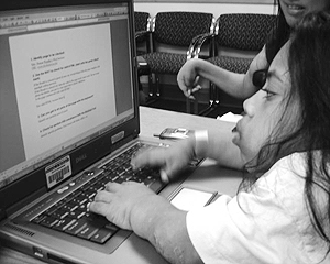 A student using a laptop