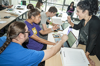 Students and instructors work together on computers.