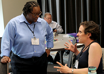 Two participants share ideas at the AccessEngineering capacity building institute.