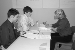 Image of two students at a disabilities meeting with a career counselor.