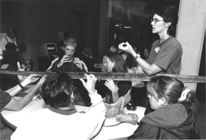 Image of an instructor working with students with disabilities in a hands on activity.