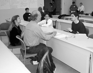Image of students participating in mock interviews with employees.