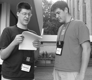 Photo of two students looking over a set of forms.