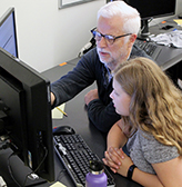 AccessCSForAll PI Richard Ladner shows a middle school student how to use Quorum.