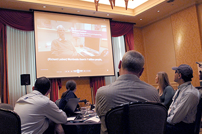 A video plays Richard speaking while participants watch.