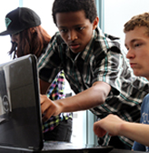 Two students who are deaf collaborate on a computing project