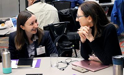 Two participants share a laugh.