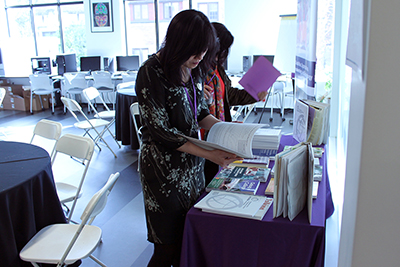 A participant looks at a brochure on the resources table.