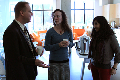 Scott Bellman chats with two participants over coffee.