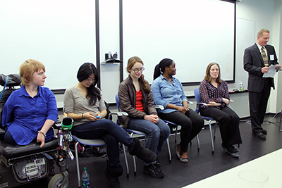 A row of students with disabilities answer questions as a panel.
