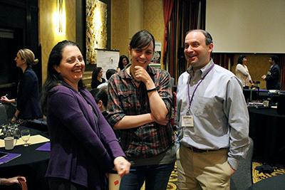 Co-PI Maya Cakmak laughs with participants.