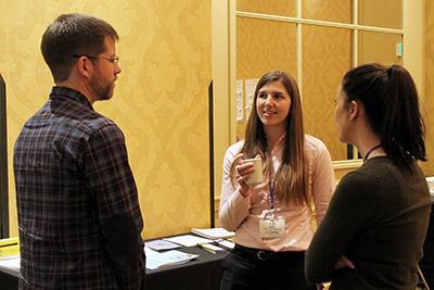Co-PI Kat Steele talks with participants.