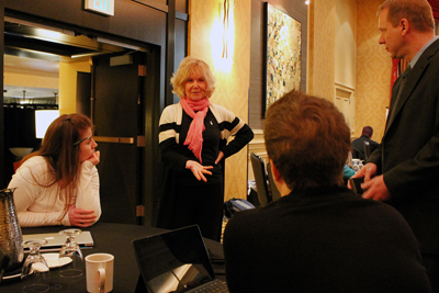 Sheryl Burgstahler explains an idea to a group at the Accessible IT CBI.