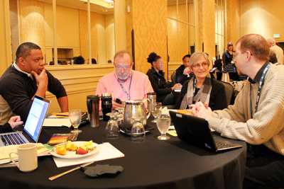A group discusses one of the posed questions during the Accessible IT CBI.