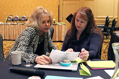 PI Sheryl Burgstahler discusses upcoming events when program coordinator Lyla Crawford.