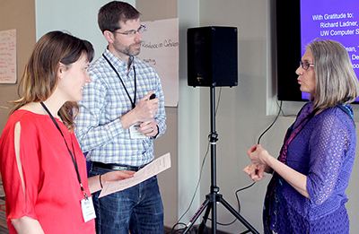Three participants chat during the AccessEngineering capacity building institute.