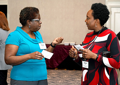 Two participants share ideas.