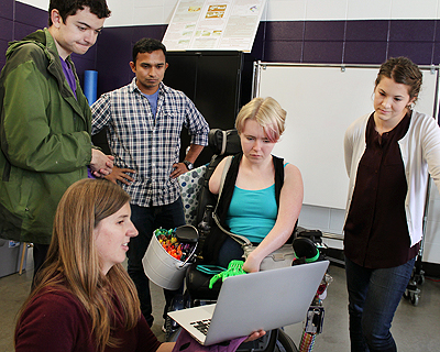 Image of instructors showing a demo to students