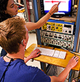 A student who is deaf works on a project in the CSNE lab