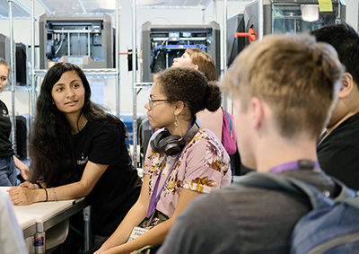 An instructor teaches students about the makerspace.