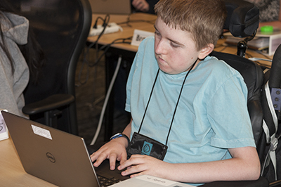 A student in a wheelchair at a computer.