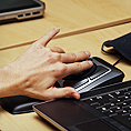 Image of a student using an assistive technology mouse