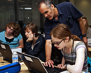 Image of an instructor assisting a student on the computer