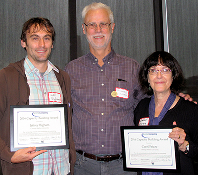 o	Jeff Bigham and Carol Frieze pose with Richard Ladner after receiving their capacity building awards.