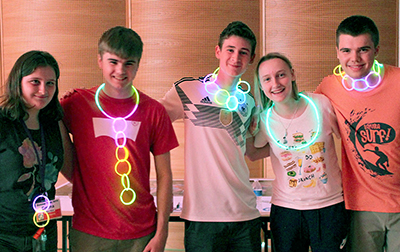 Students show off their glowing creations at the DO-IT Dance 2020.